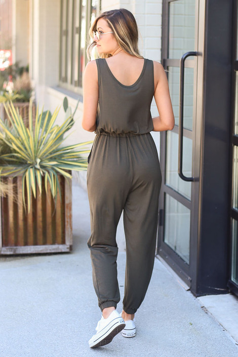 Model wearing the Jersey Knit Jumpsuit and white sneakers Back View
