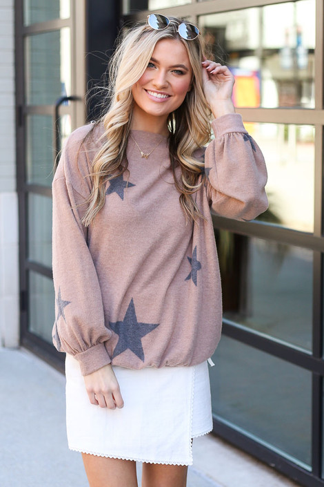 Model from Dress Up wearing the Star Brushed Knit Top with white skirt