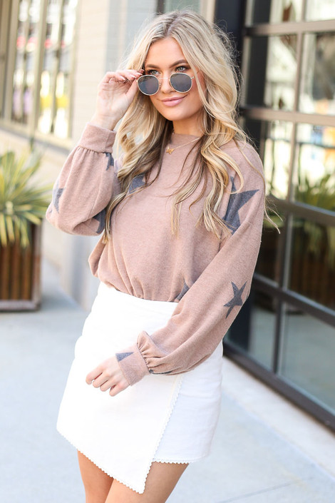 Model wearing the Star Brushed Knit Top from online dress boutique with polarized aviator sunglasses