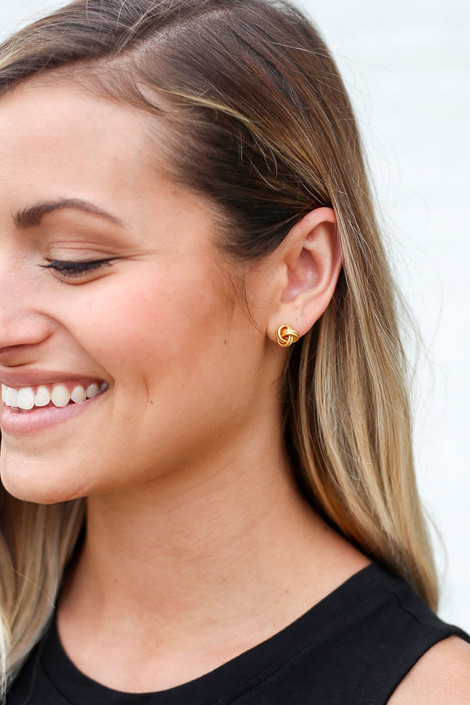 Model wearing the Knotted Stud Earrings