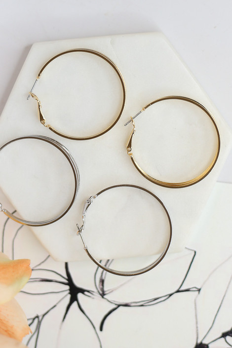 Flat Lay of the Layered Hoop Earrings in Gold and Silver