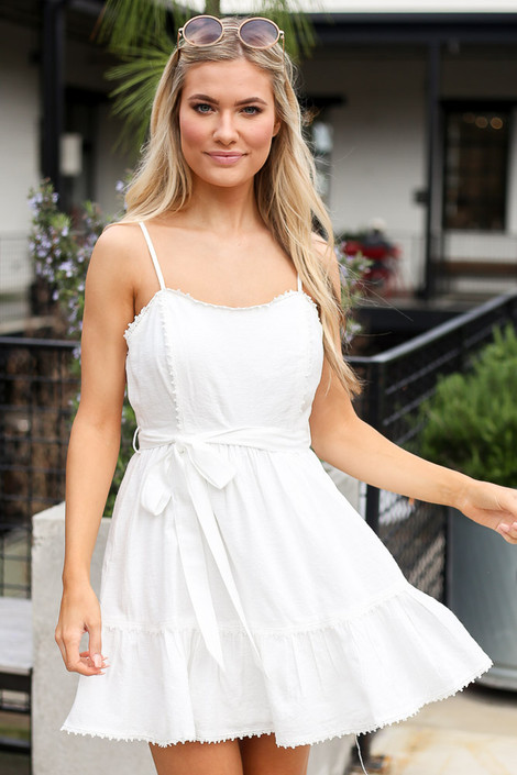Model wearing the Crochet Trim Belted Babydoll Dress from Dress Up