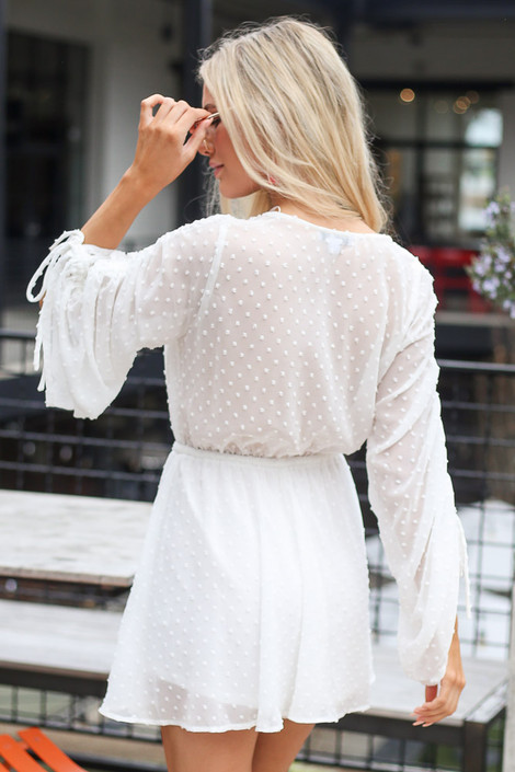 Model wearing the Gathered Sleeve Swiss Dot Romper Back View
