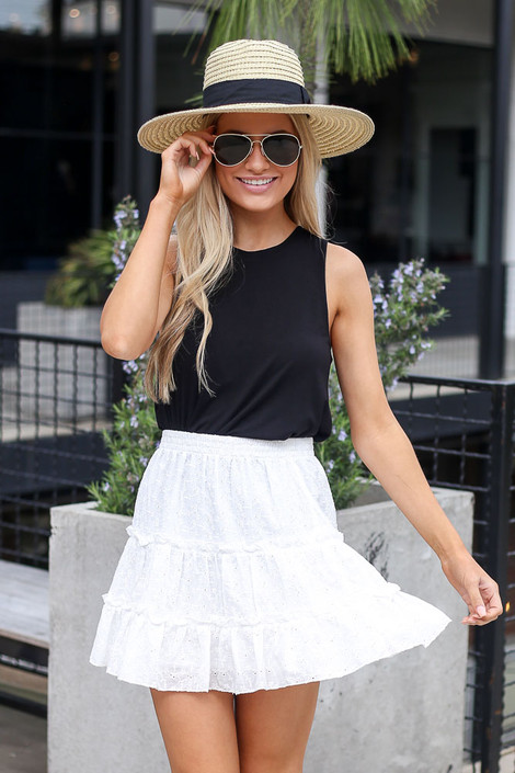 Model wearing the Eyelet Tiered Skirt in white with black tank top