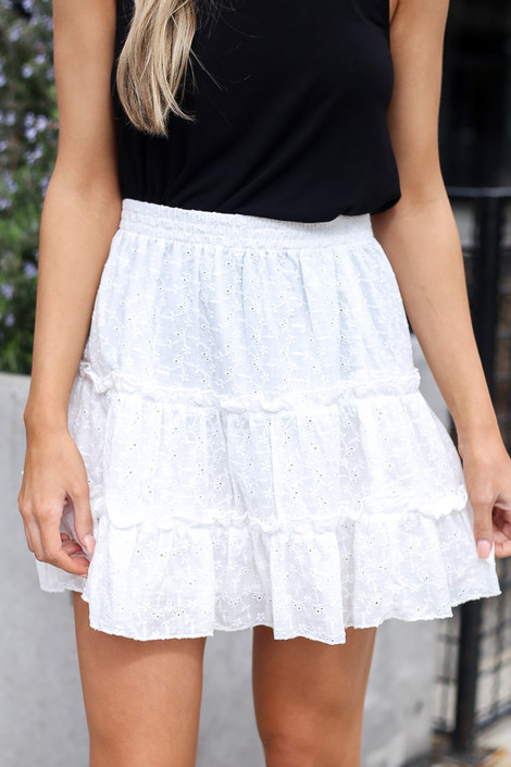 Model wearing the Eyelet Tiered Skirt in white with black tank top Close Up