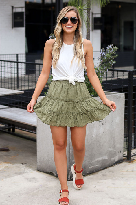Model wearing the Eyelet Tiered Skirt in Olive with white tank top and polarized aviator sunglasses full outfit view
