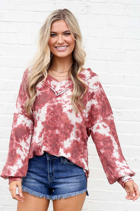 Model wearing the Tie-Dye V-Neck Waffle Knit Top with high rise shorts from dress boutique online