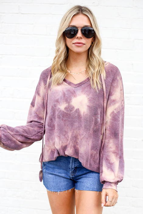 Model wearing the Tie-Dye Oversized Pullover Hoodie with high rise jean shorts from ShopDressUp