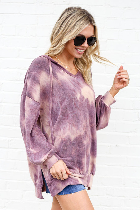Model wearing the Tie-Dye Oversized Pullover Hoodie with denim shorts from dresses boutique online Side view