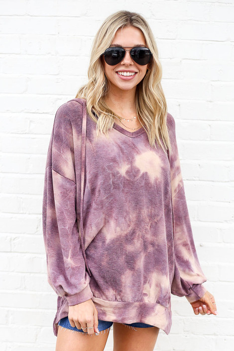 Model of Dress Up Boutique wearing the Tie-Dye Oversized Pullover Hoodie with high rise distressed denim shorts