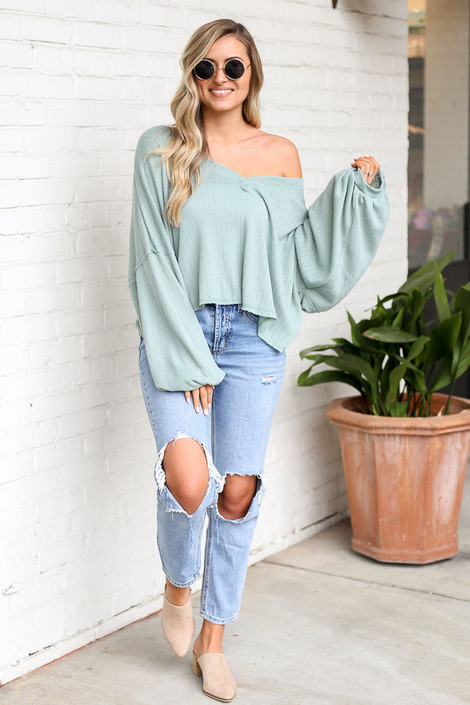 Model wearing the Lightweight Knit Balloon Sleeve Top with distressed boyfriend jeans and heeled mules