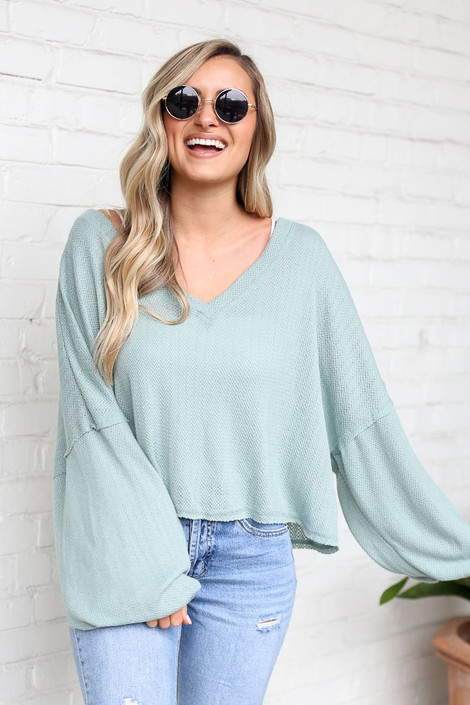 Model wearing the Lightweight Knit Balloon Sleeve Top with sunglasses