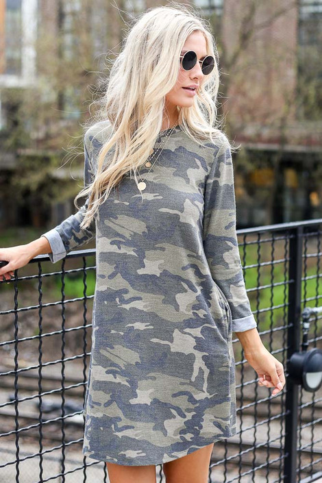 Model wearing the French Terry Camo Dress with cute sunglasses from Dress Up Boutique