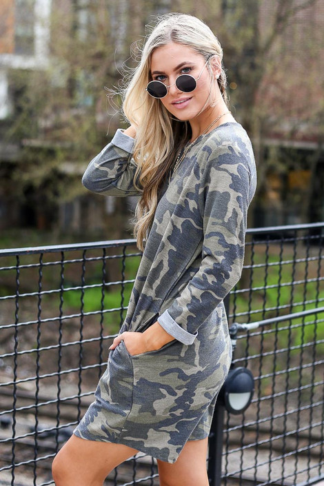 Model wearing the French Terry Camo Dress from online dress boutique with trendy sunglasses and cute sandals