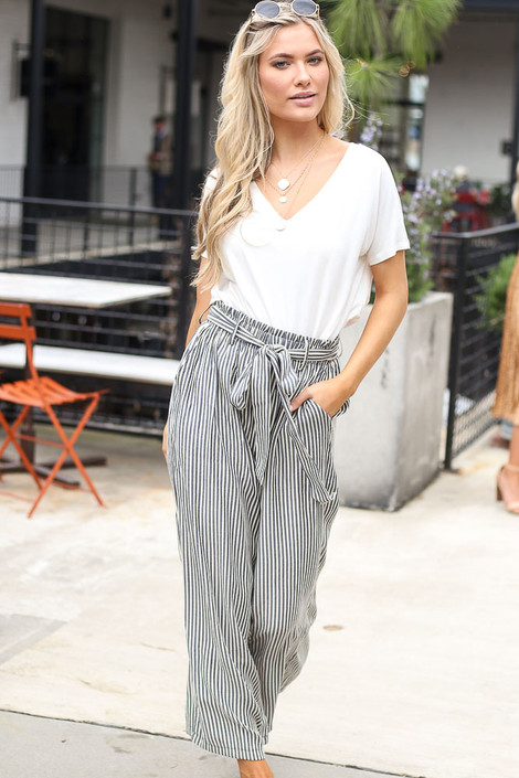 Model wearing the Tie Front Wide Leg Pants with cute sunglasses and trendy shoes from online dress boutique