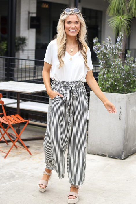 Model wearing the Tie Front Wide Leg Pants with espadrille sandals and cute sunglasses from Dress Up Boutique