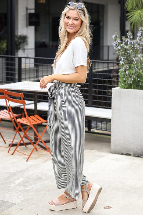 Model wearing the Tie Front Wide Leg Pants with platform sandals from Dress Up