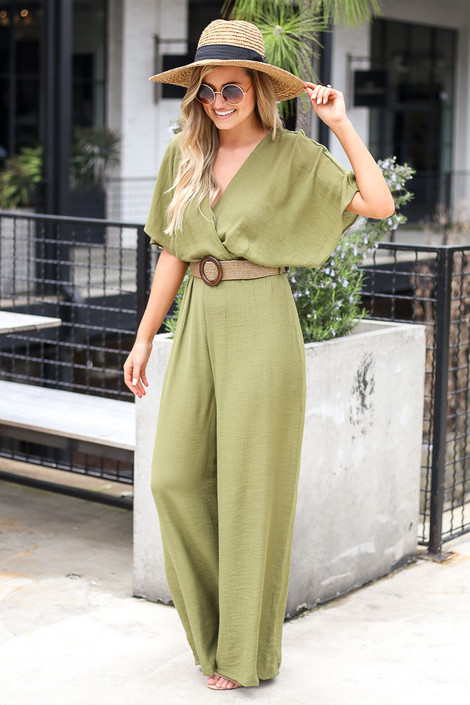 Olive - Model wearing the Belted Jumpsuit with a wide brim hat