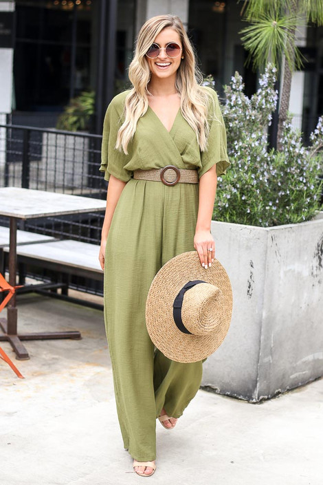 Model wearing the Belted Jumpsuit holding a wide brim hat