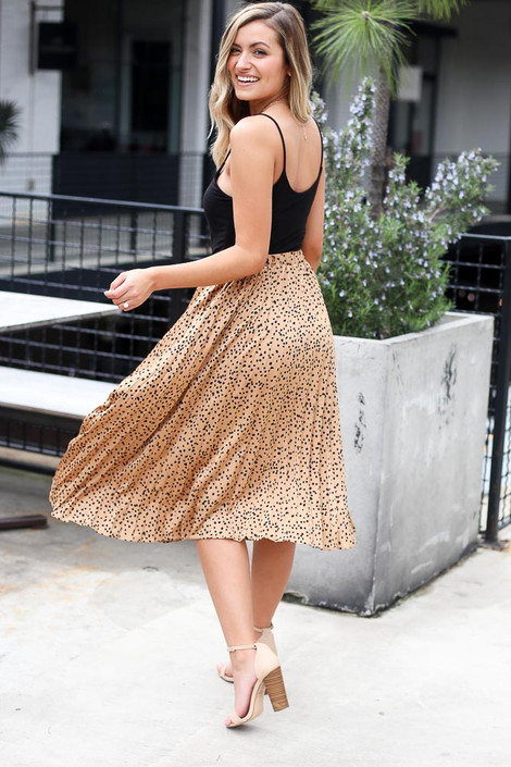 Model wearing the Spotted Pleated Midi Skirt in Tan back view