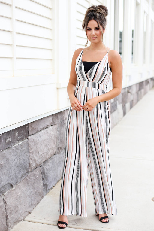 Model wearing Taupe Strapless Striped Jumpsuit