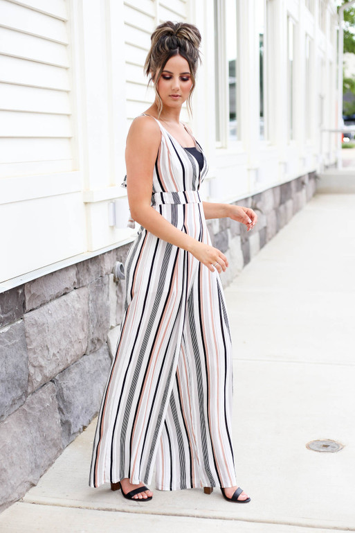 Model wearing Taupe Strapless Striped Jumpsuit Side View
