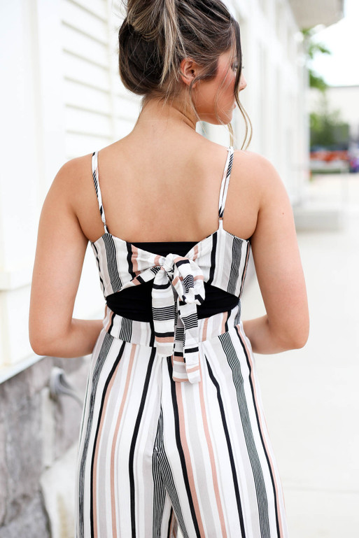 Model wearing Taupe Strapless Striped Jumpsuit Back Detail View