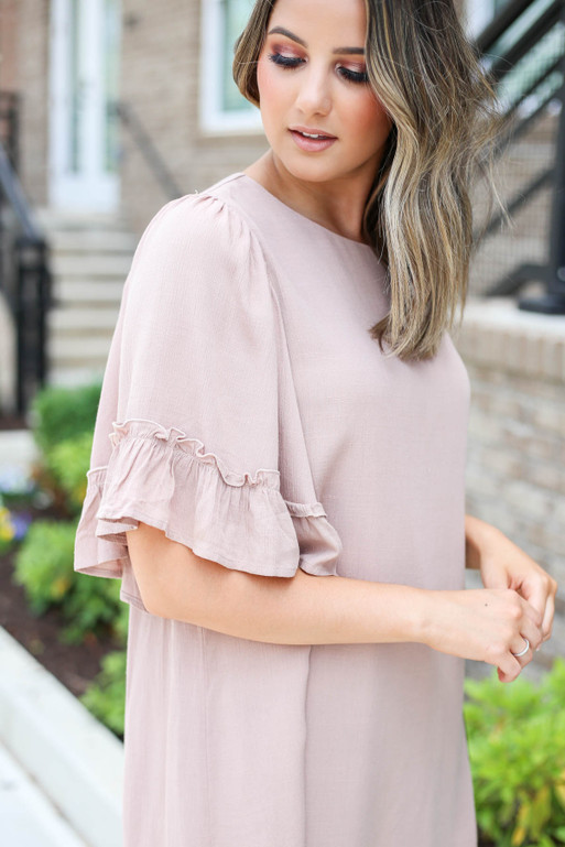 Model wearing Taupe Flowy Ruffle Sleeve Dress Detail View