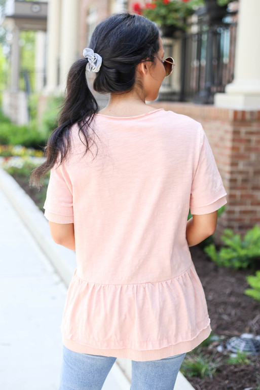 Model wearing Blush V-Neck Peplum Top Back View