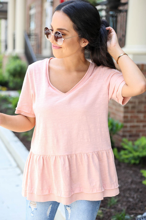 Model wearing Blush V-Neck Peplum Top Front View