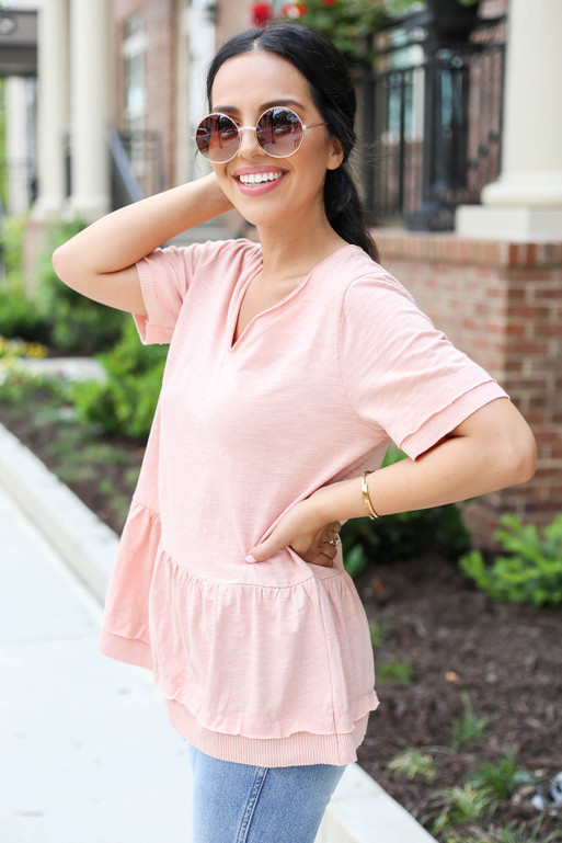 Model wearing Blush V-Neck Peplum Top Side View