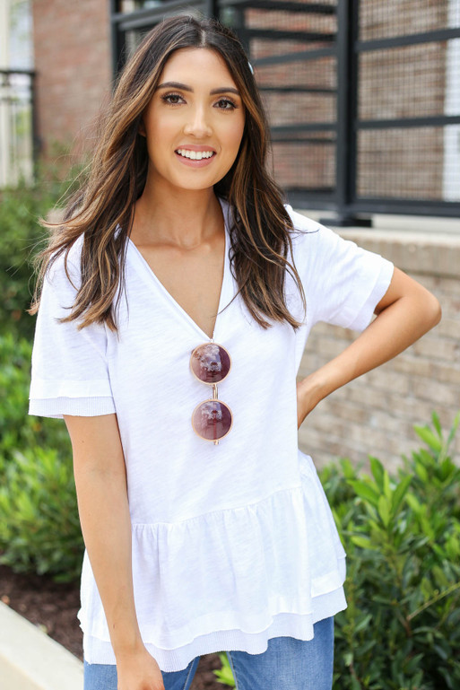 Model wearing White V-Neck Peplum Top