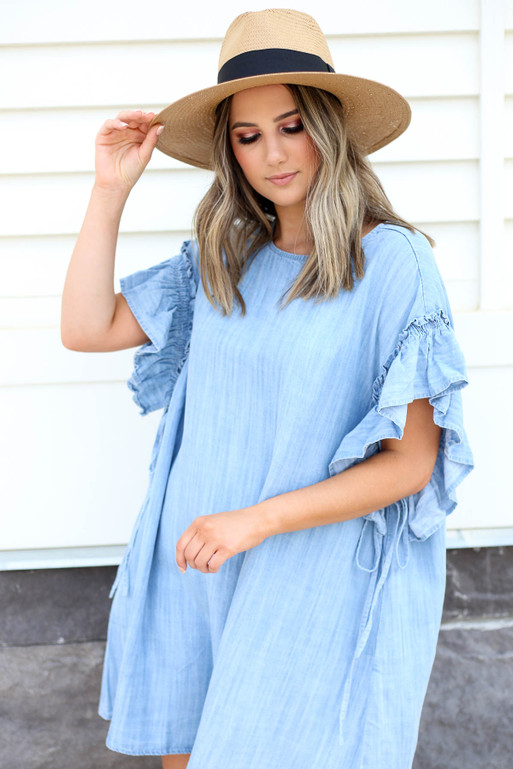 Model wearing Chambray Ruffle Sleeve Dress Front View