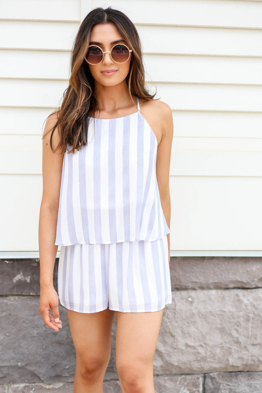 Model wearing Navy and White Striped Romper