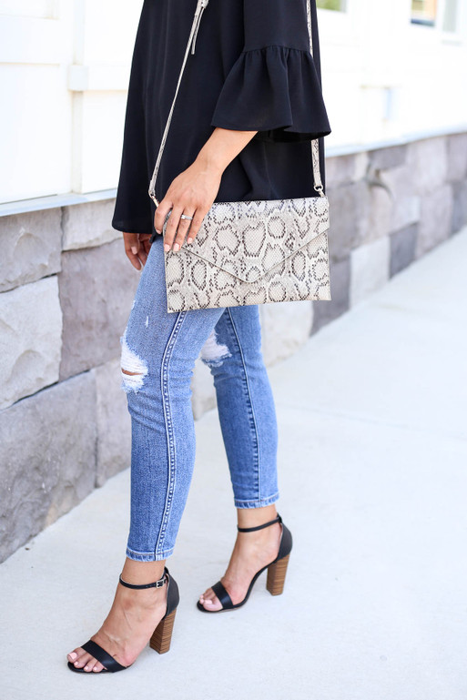 Model Carrying Snakeskin Envelope Clutch with Strap