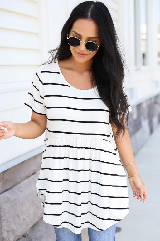 Model wearing White and Black Striped Pocketed Babydoll Tee