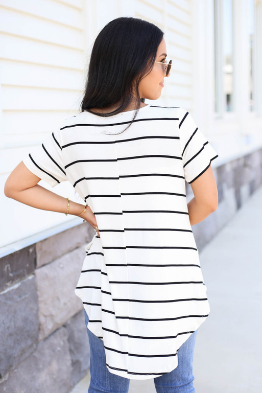 Model wearing White and Black Striped Pocketed Babydoll Tee Back View