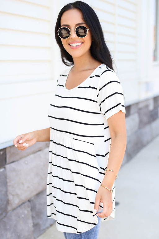 Model wearing White and Black Striped Pocketed Babydoll Tee Side View