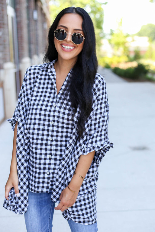Model wearing Black and White Gingham Oversized Ruffle Sleeve Top