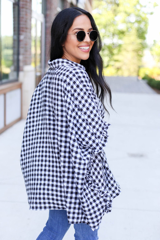 Model wearing Black and White Gingham Oversized Ruffle Sleeve Top Back View
