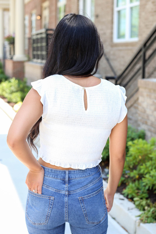 Model wearing White Ruffle Sleeve Smocked Crop Top Back View