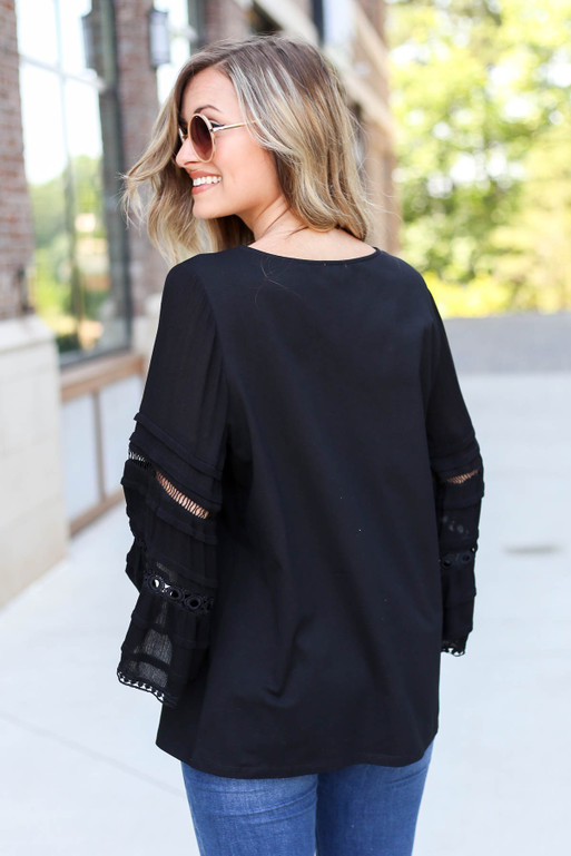 Model Wearing Black Crochet Bell Sleeve Blouse Back View