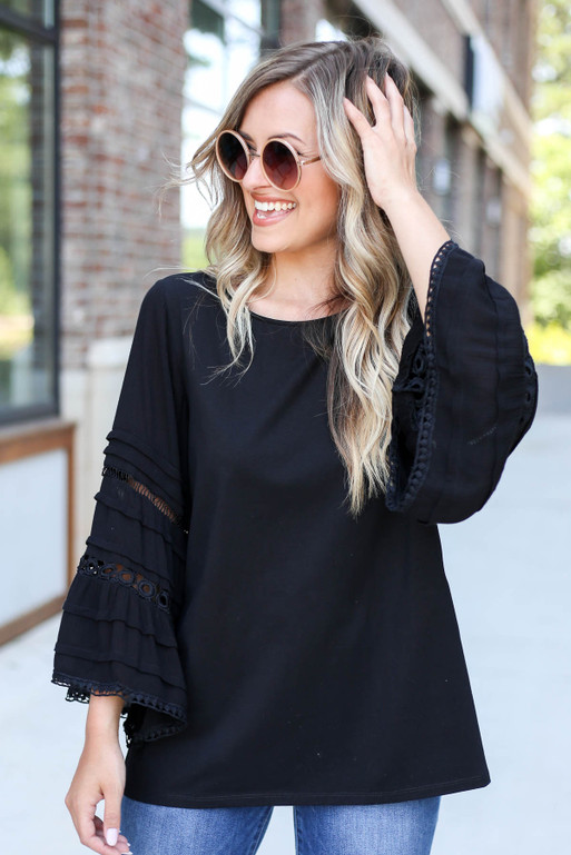 Model Wearing Black Crochet Bell Sleeve Blouse