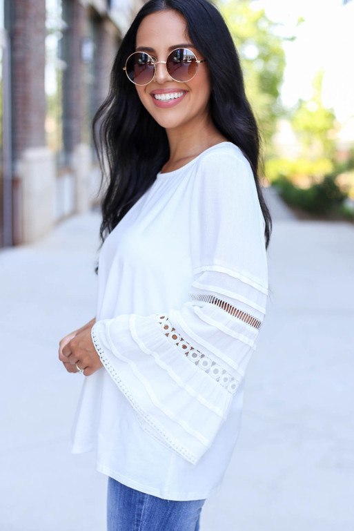 Model Wearing White Crochet Bell Sleeve Blouse Side View