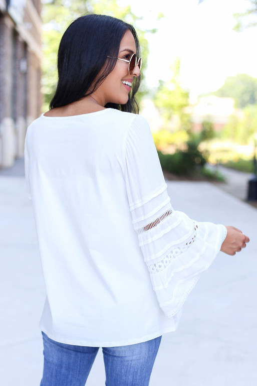 Model Wearing White Crochet Bell Sleeve Blouse Back View