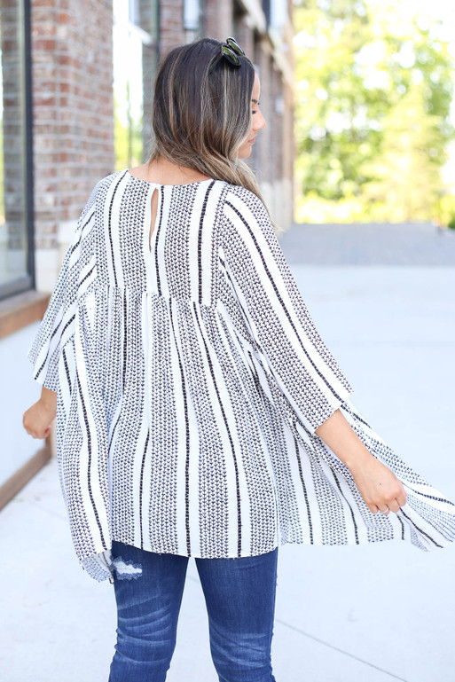 Model is wearing White Oversized Printed Tassel Blouse Back View