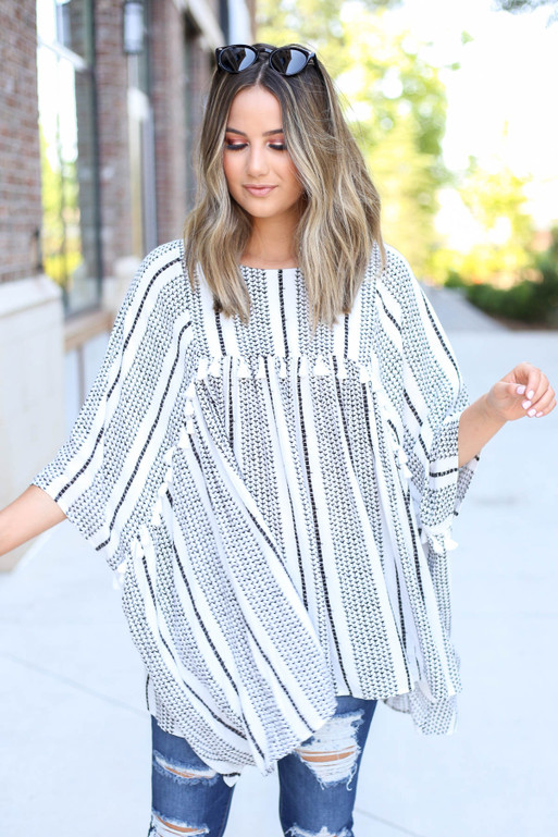 Model is wearing White Oversized Printed Tassel Blouse Front View