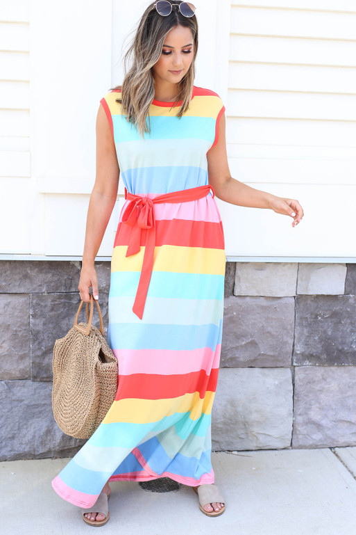 Model wearing Multi-Striped Belted Sleeveless Maxi Dress and Woven Tote Front View