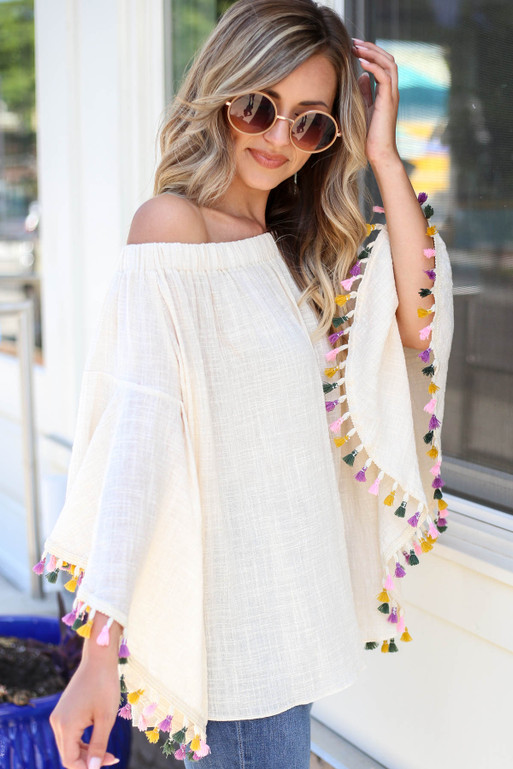 Ivory - Off the Shoulder Bell Sleeve Tassel Blouse Side View