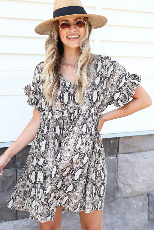 Model wearing Ruffle Sleeve Snakeskin Babydoll Dress with Hat Front View